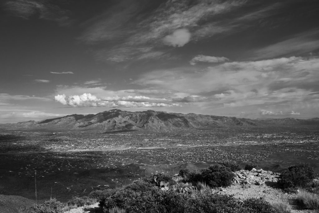 Black and white photograph of a desert mountain range.