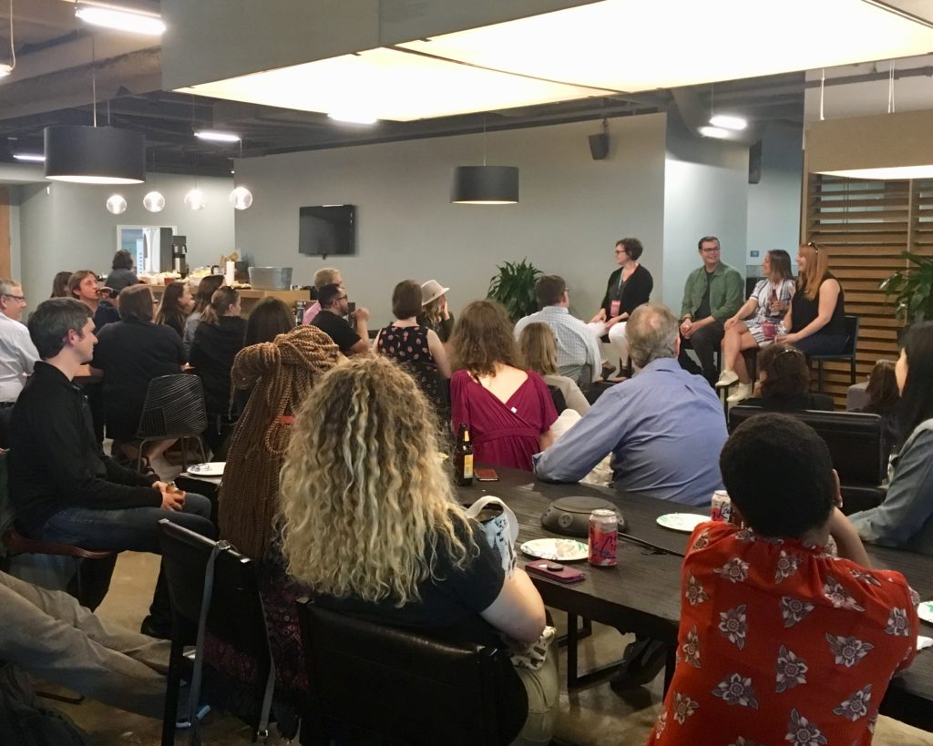 Photograph of panelists at a meetup including Kristina Halvorson, Tracy Playle, and Andy Welfle.